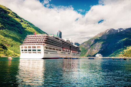 Amazing summer scene of Geiranger port, western Norway. Splendid view of Sunnylvsfjorden fjord. Traveling concept background. Artistic style post processed photo.