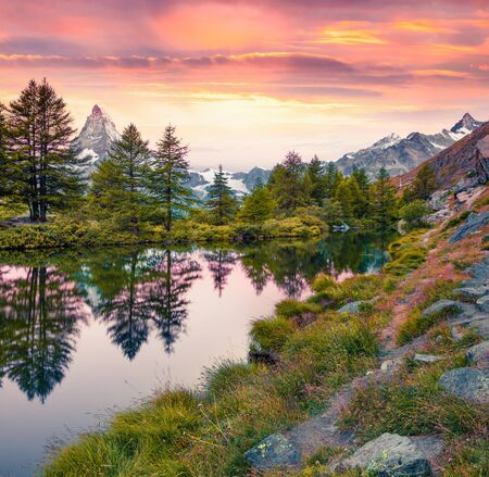 Impressive summer sunrise on the Grindjisee lake. Splendid view of  Matterhorn (Monte Cervino, Mont Cervin) peak, Swiss Alps, Zermatt location, Switzerland, Europe. Beauty of nature concept background 스톡 콘텐츠