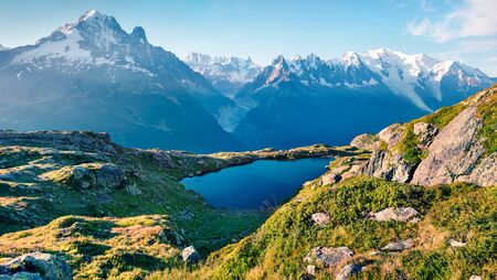 Breathtaking summer view of the Lac Blanc lake with Mont Blanc (Monte Bianco) on background, Chamonix location. Beautiful outdoor scene in Vallon de Berard Nature Preserve, Graian Alps, France, Europe.