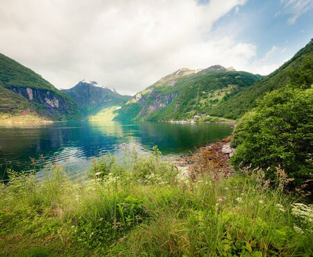 Bright summer scene of Sunnylvsfjorden fjord. Colorful morning view of western Norway, Europe. Traveling concept background.