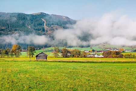 Sunny morning view of Mitterhofen village in the district of Zell am See in the Austrian state of Salzburg. Colorful autumn scene of Alps, Austria, Europe. Traveling concept background. Reklamní fotografie