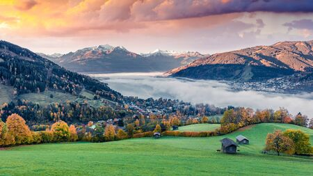 Unbelievable morning panorama of Zell lake. Dreamy autumn sunrise view of Austrian town - Zell am See, south of the city of Salzburg. Beauty of nature concept background. Reklamní fotografie