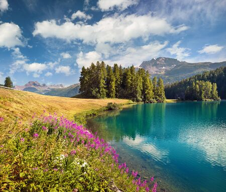 Colorful summer scene of Champferersee lake. Exciting morning view of Silvaplana village in the morning mist. Great sunny landscape of Swiss Alps, Switzerland, Europe. Beauty of nature concept background. Stock fotó