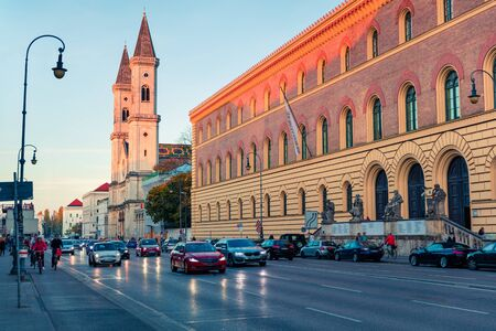 Colorful evening view of  Catholic Parish and University Church St. Louis, called Ludwigskirche. Great autumn cityscape of Munich, Bavaria, Germany. Traveling concept background.