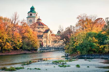 Splendid autumn view of Indoor Swimming Pool and Isar river. Bright morning cityscape of Munich, Bavaria, Germany, Europe. Traveling concept background.