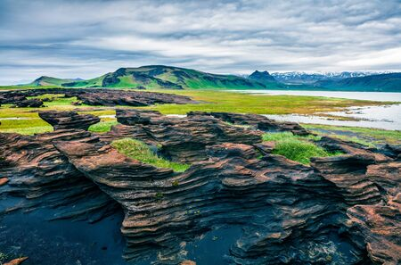 Spectacular Icelandic landscape on the south coast of Iceland. Dramatic summer morning with volcanic ground. Artistic style post processed photo.