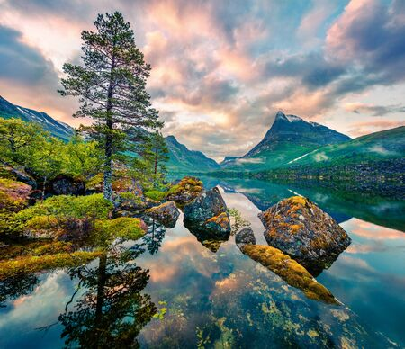 Fantastic summer sunrise on Innerdalsvatna lake. Colorful morning scene of Norway, Europe. Beauty of nature concept background. Stock fotó