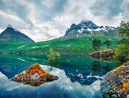 Impressive summer view of Innerdalsvatna lake. Dramatic morning scene of Norway, Europe. Beauty of nature concept background. Artistic style post processed photo.