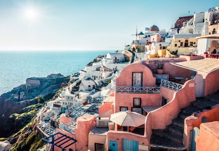Sunny morning view of Santorini island. Picturesque spring scene of the famous Greek resort Oia, Greece, Europe. Traveling concept background. Artistic style post processed photo.
