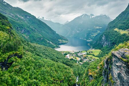 Aerial view of Geiranger port, western Norway, Europe. Spectacular summer scene of Sunnylvsfjorden fjord. Traveling concept background.