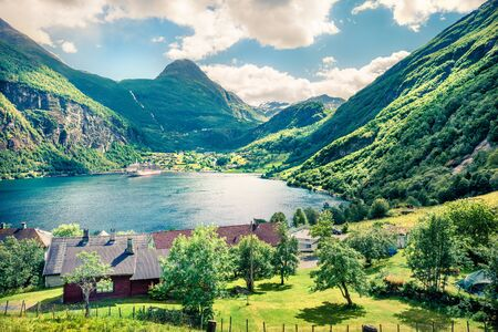 Beautiful summer scene of Geiranger port, western Norway. Sunny view of Sunnylvsfjorden fjord. Traveling concept background. Stock fotó