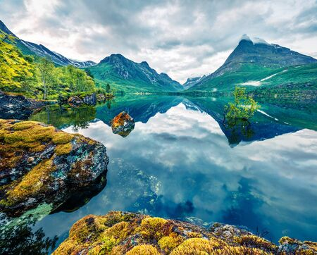 Great summer view of Innerdalsvatna lake. Breathtaking morning scene of Norway, Europe. Beauty of nature concept background. Artistic style post processed photo. Stok Fotoğraf