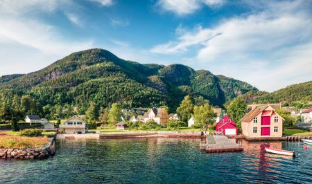 Picturesque summer view of typical Norwegian village on the shore of fjord. Traveling concept background. Artistic style post processed photo. Zdjęcie Seryjne