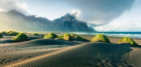 Black sand dunes on the Stokksnes headland on southeastern Icelandic coast with Vestrahorn . Picturesque summer panorama of Iceland, Europe. I