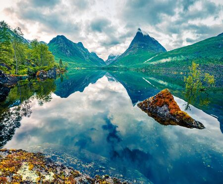 Awesome summer view of Innerdalsvatna lake. Dramatic morning scene of Norway, Europe. Beauty of nature concept background. Artistic style post processed photo.