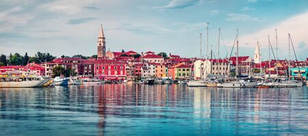 Colorful evening cityscape of old fishing town Isola. Fantastic spring seascape of Adriatic Sea. Beautiful evening panorama of Slovenia, Europe. Traveling concept background.