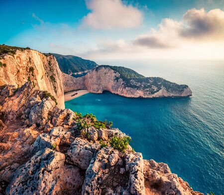 Fantastic spring voew of the Shipwreck Beach. Colorful sunset on the Ionian Sea, Zakinthos island, Greece, Europe. Beauty of nature concept background. Artistic style post processed photo. Zdjęcie Seryjne