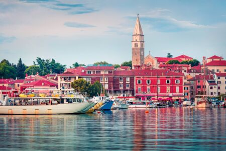 Splendid evening cityscape of old fishing town Isola. Colorful spring seascape of Adriatic Sea. Beautiful evening scene of Slovenia, Europe. Traveling concept background. Zdjęcie Seryjne