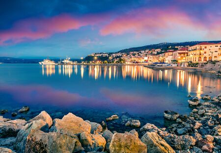 Exciting evening view of Pilos town. Colorful spring sunset on Ionian Sea. Beautiful cityscape of Greece city. Traveling concept background. Artistic style post processed photo.