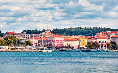 Splendid morning cityscape of popular summer resort Porec. Colorful spring seascape of Adriatic Sea. Wonderful scene of Istrian Peninsula in western Croatia, Europe. Traveling concept background. Zdjęcie Seryjne