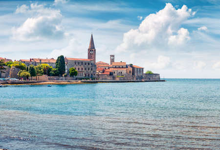 Amazing spring view of old Assumption of Mary church. Sunny morning cityscape in Porec, Croatia, Europe. Traveling concept background.