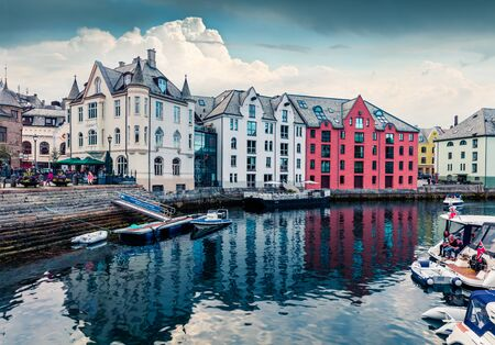Picturesque summer view of Alesund port town on the west coast of Norway, at the entrance to the Geirangerfjord. Colorful morning cityscape. Traveling concept background. Zdjęcie Seryjne