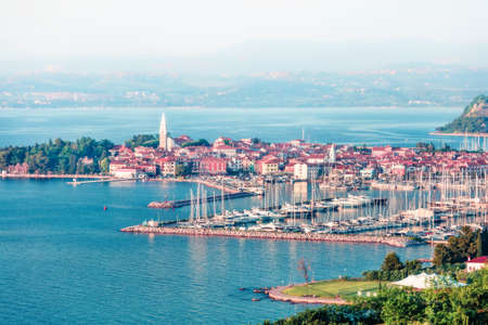 Aerial view of old fishing town Izola. Colorful spring seascapeof Adriatic Sea. Beautiful view of Slovenia, Europe. Beauty of countryside concept background.