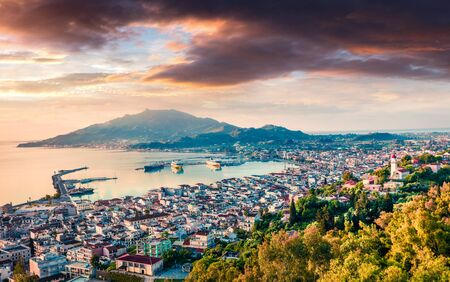 Aerial view of Zakynthos (Zante) town. Dramatic spring sunrise on Ionian Sea. Beautiful cityscape panorama of Greece city. Traveling concept background. Artistic style post processed photo. Zdjęcie Seryjne