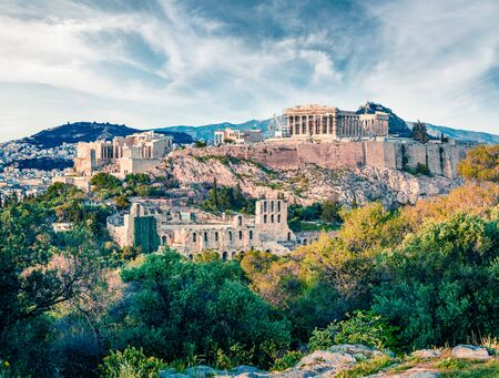 Beautiful spring view of Parthenon, former temple, on the Athenian Acropolis, Greece, Europe. Colorful morning scene in Athens. Treveling concept background.