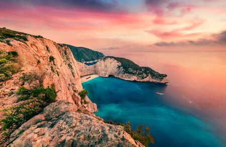 Colorful spring scene of Shipwreck Beach. Impressive evening seascape ofIonian Sea, Zakinthos island, Greece, Europe. Beauty of nature concept background. Artistic style post processed photo.