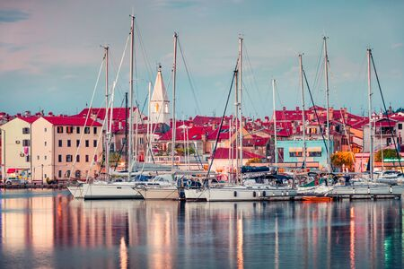 Wonderful evening cityscape of old fishing town Isola. Colorful spring seascape of Adriatic Sea. Beautiful outdoor scene of Slovenia, Europe. Traveling concept background. Zdjęcie Seryjne