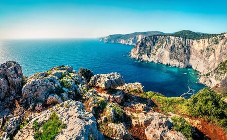 Aerial spring view of high cliffs on the Ionian Sea. Bright morning seascape of Zakynthos (Zante) island, Greece, Europe. Beauty of nature concept background.