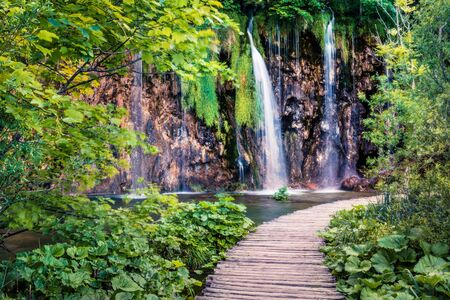 Fantastic morning view of Plitvice National Park. Colorful spring scene of green forest with pure water waterfall. Beautiful countryside landscape of Croatia, Europe. Traveling concept background. 스톡 콘텐츠