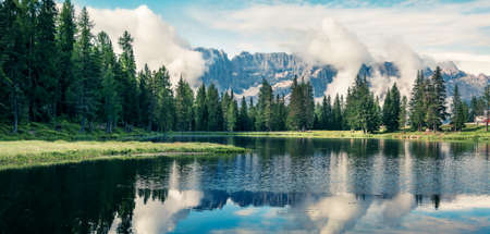 Foggy morning panorama of Antorno lake with Cristallo mountain range on background. Picturesque autumn view of Dolomite Alps, Province of Belluno, Italy, Europe. Zdjęcie Seryjne