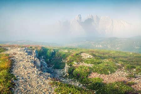 Fabulous summer view of Gruppo Del Cristallo mountain range in Tre Cime Di Lavaredo national park. Misty morning scene of Dolomite Alps, Italy, Europe. Beauty of nature concept background. Orton Effect.