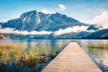 Stunning autumn scene of Altausseer See lake Trisselwand peak on background. Misty morning view of Altaussee village, district of Liezen in Styria, Austria, Europe. Orton Effect. Zdjęcie Seryjne