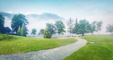 Captivating summer scene of Triglav national park, Bohinj lake location. Misty morning panorama of Julian Alps, Slovenia, Europe.
