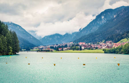 Great summer view of Auronzo di Cadore and its lake in province of Belluno, Veneto, Italy. Dramatic morning scene of Dolomite Alps. Traveling concept background. Orton Effect.
