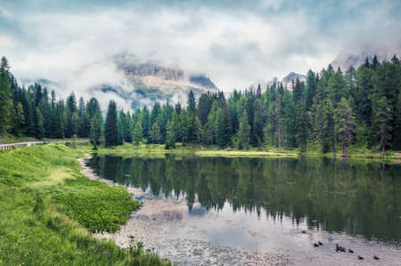 Beautiful summer scene of Antorno lake with Tre Cime di Lavaredo (Drei Zinnen) mount in the morning mist. Misty morning view of Dolomite Alps, Italy, Europe. Beauty of nature concept background.