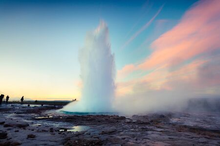Erupting of the Great Geysir lies in Haukadalur valley on the slopes of Laugarfjall hill. Early morning in Southwestern Iceland, Europe. Beauty of nature concept background.