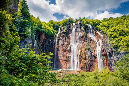 Colorful spring scene of green forest with pure water waterfall in Plitvice National Park. Sunny countryside landscape of Croatia, Europe. Beauty of nature concept background.