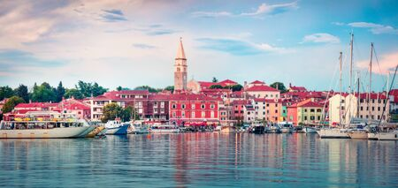 Colorful evening cityscape of old fishing town Isola. Fantastic spring seascape of Adriatic Sea. Beautiful evening panorama of Slovenia, Europe. Traveling concept background. Orton Effect. Zdjęcie Seryjne