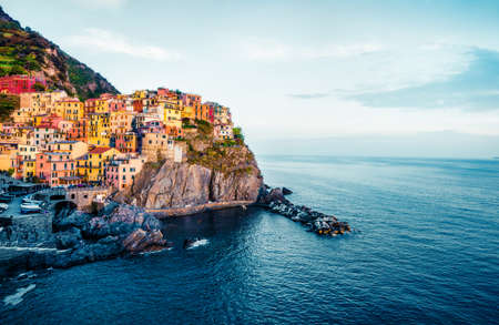 Second city of the Cique Terre sequence of hill cities - Manarola. Colorful spring morning in Liguria, Italy, Europe. Picturesqie seascape of Mediterranean sea.