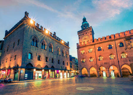Beautiful spring sunset on main square of City of Bologna with Palazzo d'Accursio and facade of Basilica di San Petronio. Great cityscape of Bologna, Italy, Europe. Traveling concept background. Zdjęcie Seryjne
