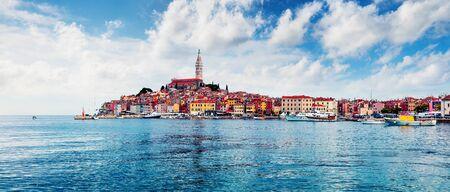Stunning spring cityscape of Rovinj town, Croatian fishing port on the west coast of the Istrian peninsula. Bright morning seascape of Adriatic Sea. Traveling concept background.
