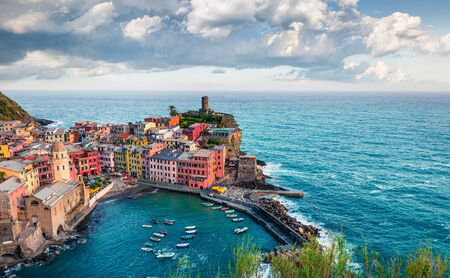 One of the five towns that make up the Cinque Terre region - Vernazza. Aerial spring view of Liguria, Italy, Europe. Splendid seascape of Mediterranean sea. Traveling concept background.