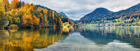 Panoramic autumn view on Grundlsee lake. Gereat morning scene of Brauhof village, Styria stare of Austria, Europe. Colorful view of Alps. Traveling concept background.
