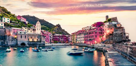 One of the five towns that make up the Cinque Terre region - Vernazza. Great spring sunrise in Liguria, Italy, Europe. Splendid seascape of Mediterranean sea. Traveling concept background. Фото со стока