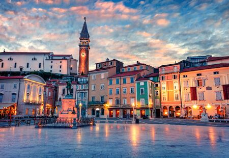Spectacular evening view of Tartini Square in old town Piran. Splendid spring sunset in Slovenia, Europe. Traveling concept background. Beautiful Mediterranean cityscape.