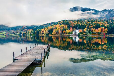 Foggy autumn view of Grundlsee lake. Cololrful morning scene of Brauhof village, Styria stare of Austria, Europe. Colorful view of Alps. Traveling concept background. Orton Effect.
